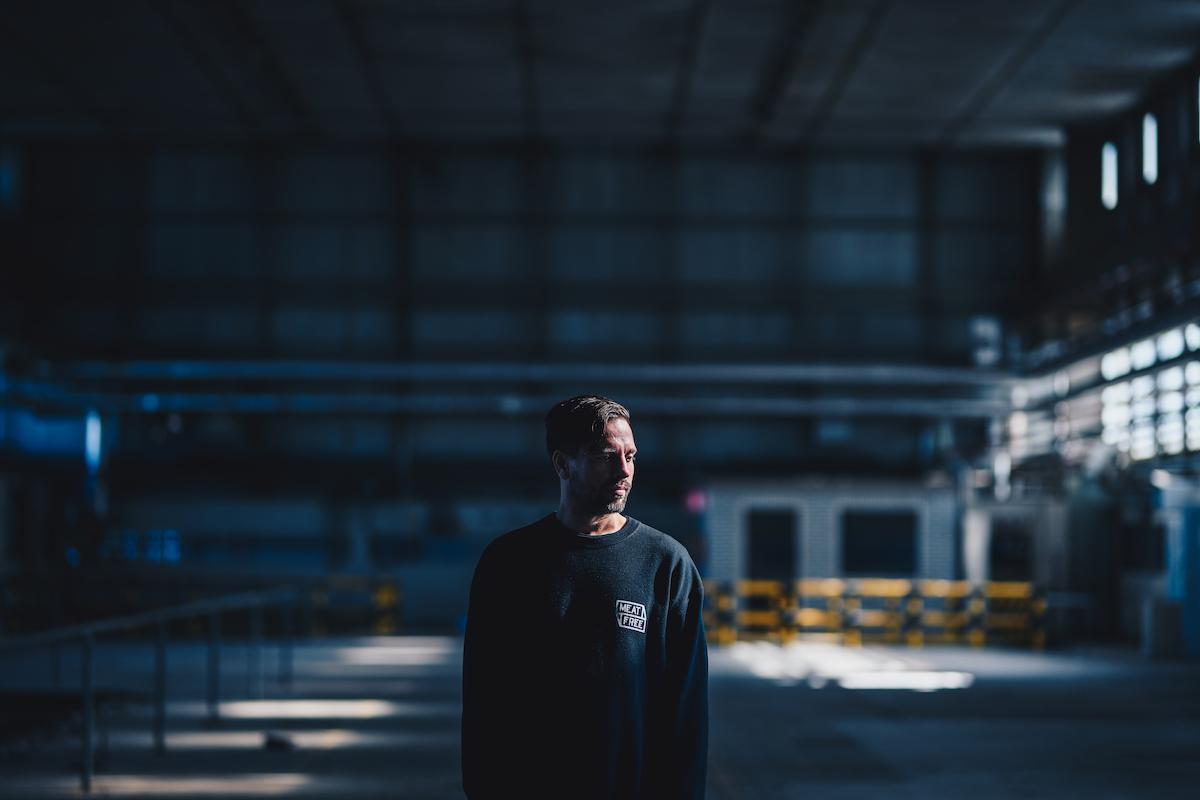 Tripeo in warehouse wearing Meat Free long-sleeve shirt